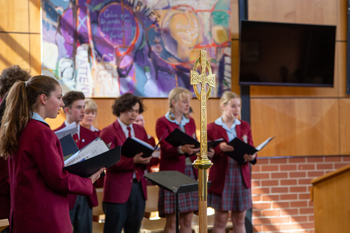 Students singing in the chapel