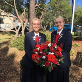 Chloe And Holly Williams With The Toorak College Wreath