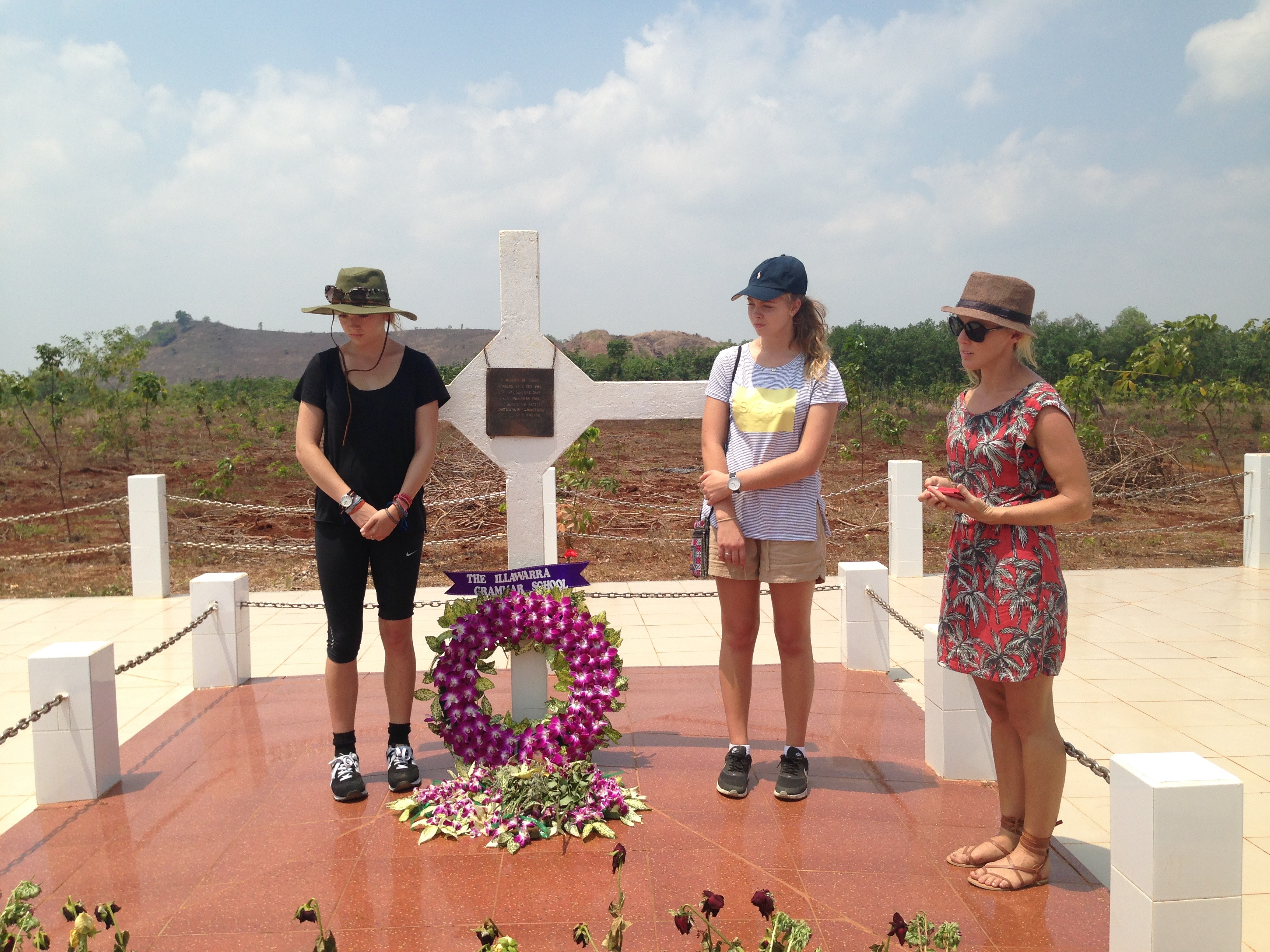 Lilly Sands, Lucie Johnston and Mrs Lowe pay their respects at the Long Tan memorial